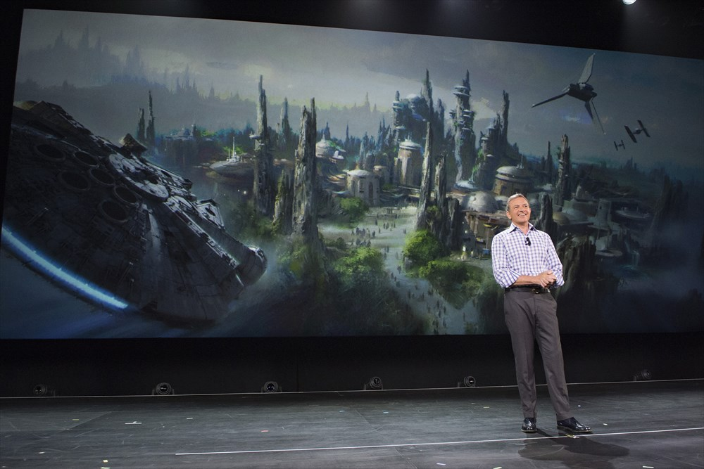 Walt Disney Company Chairman and CEO Bob Iger announced at D23 EXPO 2015 that Star Wars-themed lands will be coming to Disneyland park in Anaheim, Calif., and Disney's Hollywood Studios in Orlando, Fla., creating Disney's largest single-themed land expansions ever at 14-acres each, transporting guests to a never-before-seen planet, a remote trading port and one of the last stops before wild space where Star Wars characters and their stories come to life.  These authentic lands will have two signature attractions, including the ability to take the controls of one of the most recognizable ships in the galaxy, the Millennium Falcon, on a customized secret mission, and an epic Star Wars adventure that puts guests in the middle of a climactic battle. (Richard Harbaugh/Disney Parks) (c)Disney