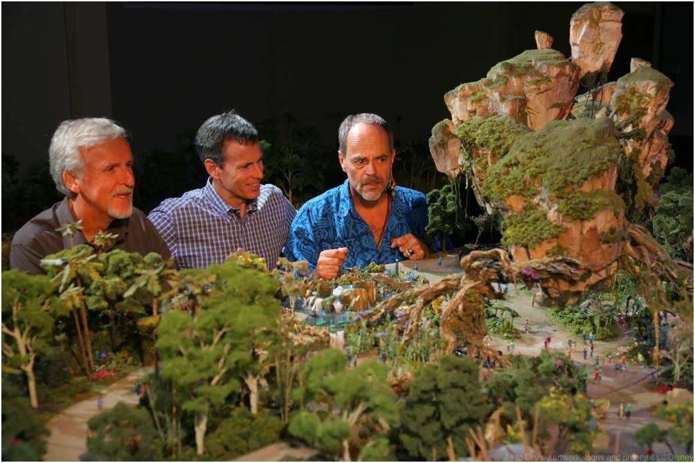 Walt Disney Imagineering in collaboration with filmmaker James Cameron and Lightstorm Entertainment is bringing to life the mythical world of Pandora, inspired by Cameron's AVATAR, at Disney's Animal Kingdom theme park. WDI's Joe Rohde (right) shares highlights of the project model with Cameron (left) and Walt Disney Parks & Resort Chairman Tom Staggs. Scheduled to open in 2017, the AVATAR-inspired land will be part of the largest expansion in Disney's Animal Kingdom history. (Disney)